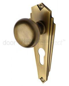 Heritage BR1848 Antique Brass Broadway Knob on Euro Plate